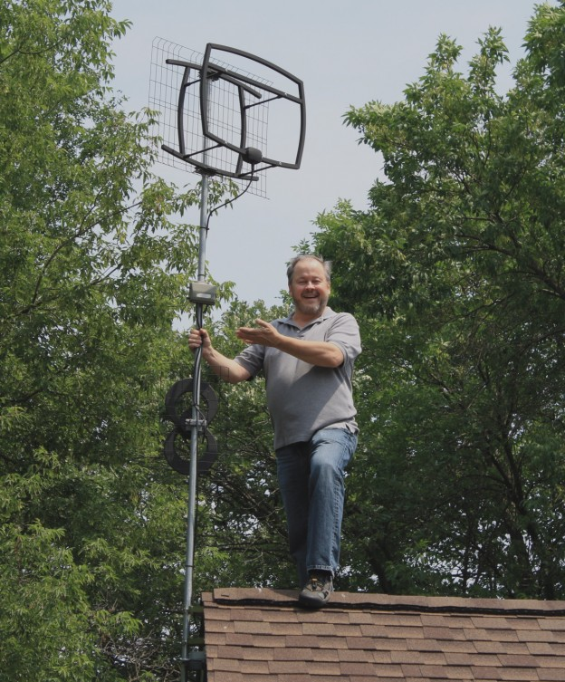 Results image of Tom Kozial on roof with Antennas Direct antenna