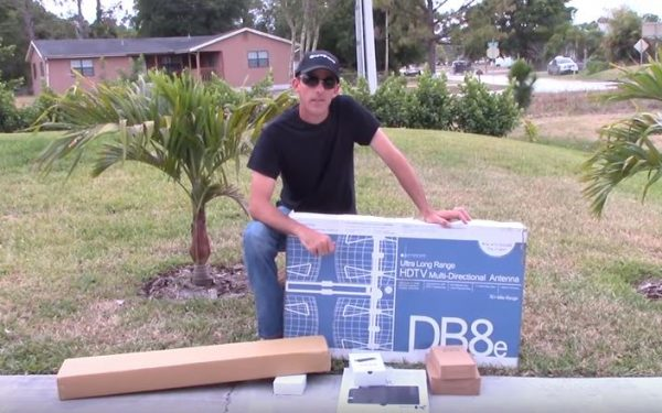 Results image of man holding DB8 box