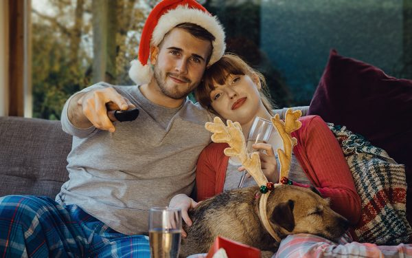 Results image of couple with dog and remote