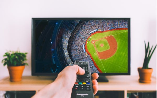 Results image of person pointing remote at TV